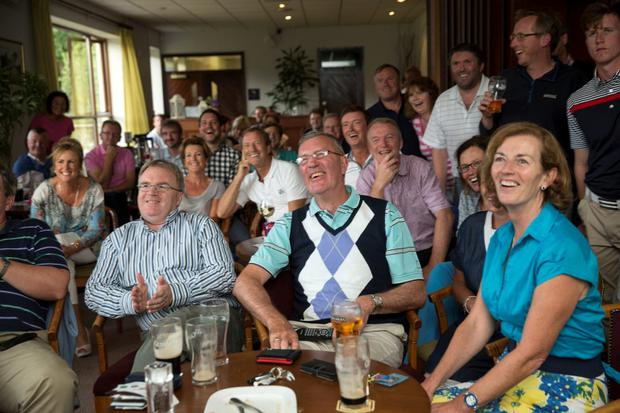 Members of the Greystones Golf club watching Paul Dunne taking part in the Open in Scotland Credit: Arthur Carron