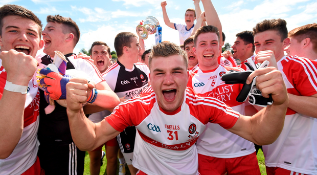 Niall Smith and his Derry team-mates celebrate their side's victory over Cavan