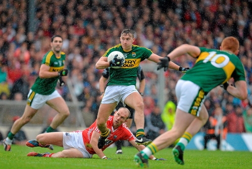 James O'Donoghue, Kerry, breaks clear of Alan O'Connor, Cork during the bad weather which lasted throughout the Munster GAA Football Senior Championship Final Replay, Kerry v Cork