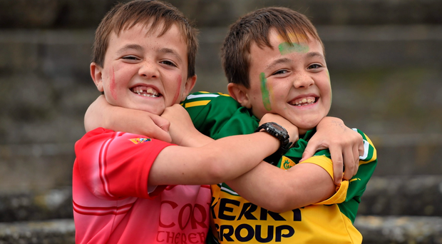 Twins Jack, supporting Cork, left, and Conor O'Keeffe, supporting Kerry, age 9, from Firies, Co. Kerry, ahead of the game at Fitzgerald Stadium