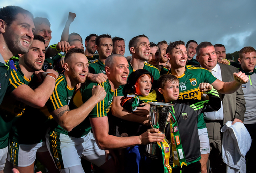 The Kerry team celebrate with the cup after the game
