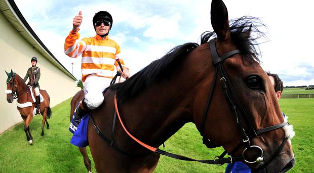 Pat Smullen gives the thumbs-up after his victory aboard Covert Love in Saturday's Irish Oaks
