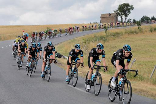 Team Sky with Luke Rowe, Wout Poels, Nicolas Roche, Ian Stannard, Richie Porte, Leopold Konig, Geraint Thomas, and race leader Chris Froome, leads the pack during yesterday's stage to Valence