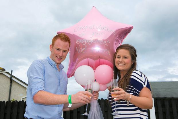 Childhood sweet hearts Noel Canavan and Ciara Kavanagh from Arklow Co.Wicklow celebrate their engagemant after Noel proposed using a banner at the Bray airshow on Sunday(Pic.Michael Kelly)
