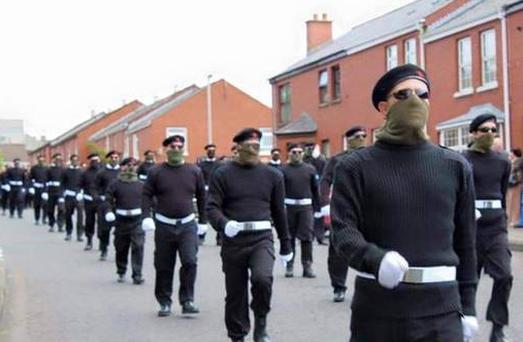 Dozens of masked men and women marched through Derry today during the funeral of veteran republican Peggy O'Hara.