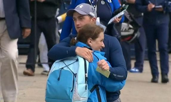 Paul Dunne and his mother Michelle embrace after his third round at St Andrews