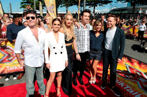 (left to right) Simon Cowell, Cheryl Fernandez-Versini, Rita Ora, Nick Grimshaw, Caroline Flack and Olly Murs arrive for the X Factor auditions at the SSE Arena, Wembley, London.