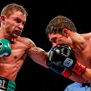 Carl Frampton, left, exchanges punches with Alejandro Gonzales Jr during their IBF Super-Bantamweight title fight last year