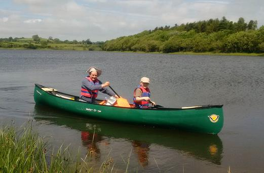Cadogan Enright, 51, with his nine-year-old son, Cad Og who are hoping to paddle to almost 70 islands on Strangford Lough in an epic bid to count butterflies.