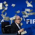 Sepp Blatter covered in bank notes