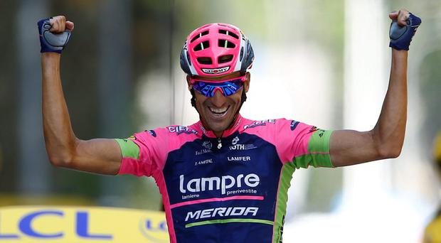 Lampre-Merida rider Ruben Plaza Molina of Spain celebrates as he crosses the finish line to win the 201-km (124 miles) 16th stage of the 102nd Tour de France