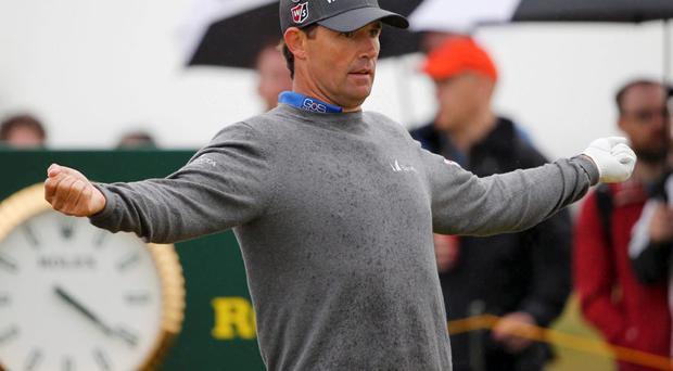 Padraig Harrington stretches before playing his tee shot on the tenth hole during the final round of the British Open golf championship on the Old Course in St. Andrews