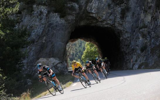 Nicolas Roche leads race leader and team-mate Chris Froome on a descent during yesterday's 16th stage of the Tour