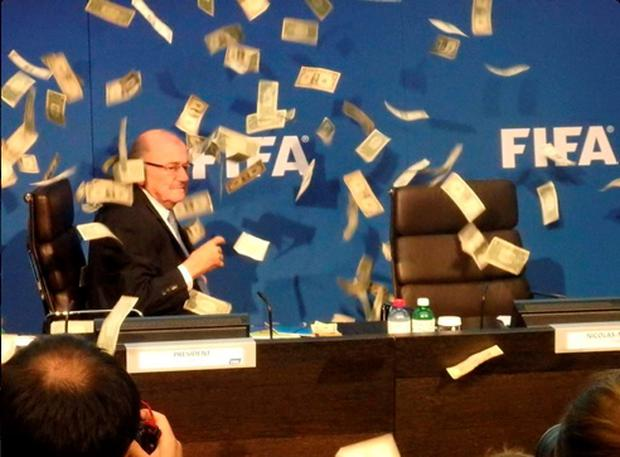 British comedian Lee Nelson (out of picture) throws cash at Sepp Blatter during an Executive Committee Meeting at FIFA Headquarters, Zurich. Photo: PA