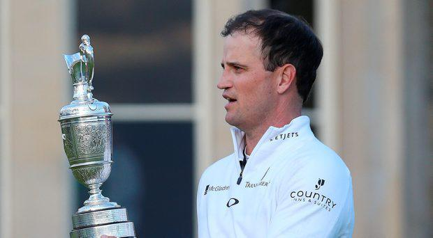 USA's Zach Johnson celebrates with the Claret Jug after winning The Open Championship at St Andrews, Fife