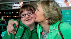 Team Ireland's Laura Ahern, a member of Owenabue Special Olympics Gymnastics Club, from Glanmire, Co Cork, is kissed by her mother Rena ahead of departing for the Special Olympics World Summer Games in Los Angeles. Picture credit: Ray McManus / SPORTSFILE