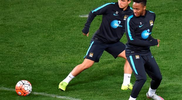 Manchester City midfielder Raheem Sterling (R) watches the ball during a team football training session during the International Champions Cup tournament in Melbourne