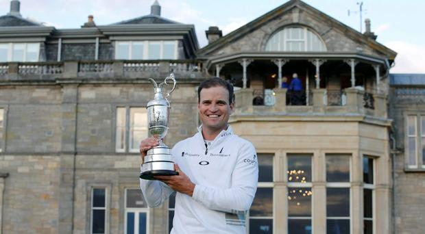 Zach Johnson of the U.S. celebrates as he holds the Claret Jug after winning the British Open golf championship on the Old Course in St. Andrews