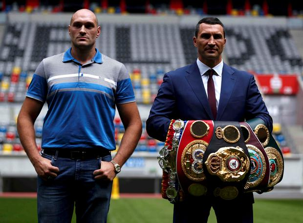 Ukrainian boxer Vladimir Klitschko and British boxer Tyson Fury (L) pose during a news conference in Duesseldorf, Germany July 21, 2015. Unbeaten Fury will get a shot at the world heavyweight title in October after agreeing terms for a meeting with champion Klitschko. REUTERS/Ina Fassbender