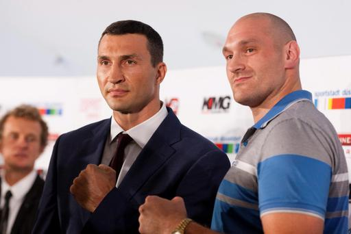 WBO, WBA, IBF and IBO heavyweight champion Wladimir Klitschko from Ukraine, left, and his challenger, Britains Tyson Fury, pose dur ing a news conference Tuesday, July 21, 2015 in Duesseldorf, western Germany. Fury, the official WBA challenger, will fight against Klitschko in the Esprit arena in Duesseldorf on Oct. 24, 2015. (AP Photo/Bernd Lauter)