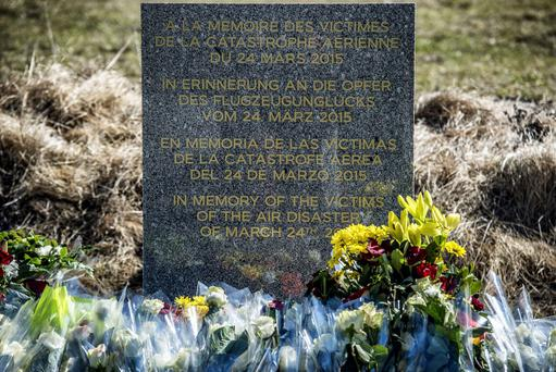 A memorial, carved in French, German, Spanish and English, in memory of the victims of the Germanwings Airbus A320 crash
