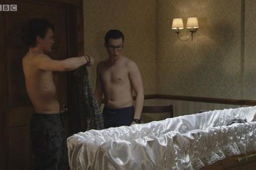 The scene showed Ben Mitchell and Paul Coker strip down to their boxers while a dead body lay in a casket next to them.