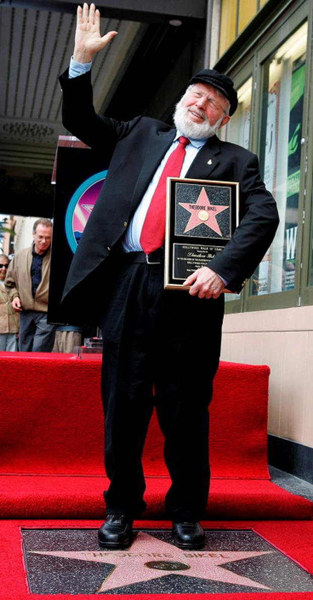 Actor Theodore Bikel sings lyrics from 'Fiddler on the Roof,' in which he appeared more than 2,000 times, after receiving a star on the Hollywood Walk of Fame in Hollywood, in this April 29, 2005 file picture. REUTERS/Lucy Nicholson/Files