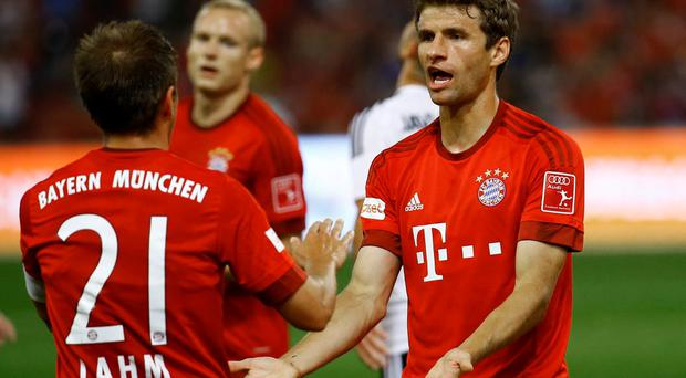 Bayern Munich's Thomas Müller celebrates with Philipp Lahm after his first goal against Valencia during their friendly match