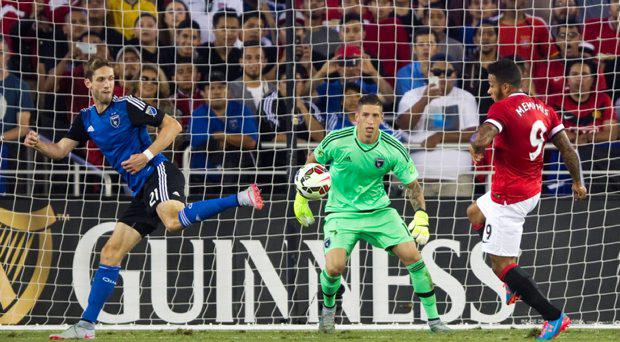 Manchester United's Memphis Depay (R) in action with San Jose Earthquakes' Clarence Goodson (L) and David Bingham (C)