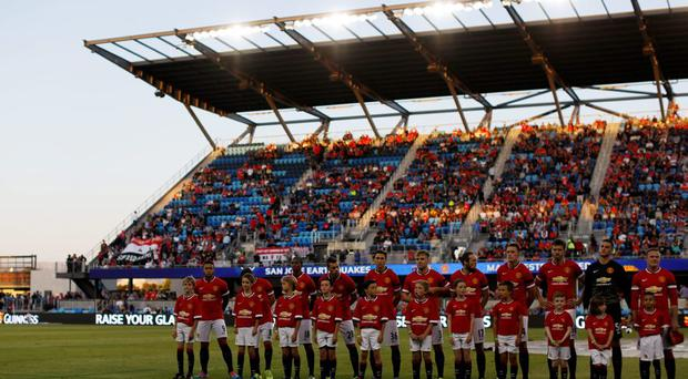 Members of of Manchester United stand on the field before their International Champions Cup match against San Jose Earthquakes