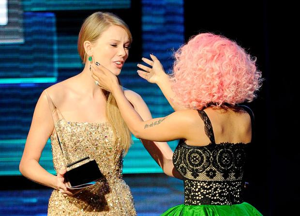 Singer Nicki Minaj (R) accepts Rap/Hip-Hop Favorite Album award from singer Taylor Swift onstage at the 2011 American Music Awards held at Nokia Theatre L.A. LIVE on November 20, 2011 in Los Angeles, California. (Photo by Kevork Djansezian/Getty Images)