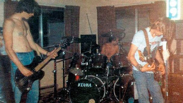 Kurt Cobain and Nirvana play their first concert in the basement of Tony Poukkula's home in 1987