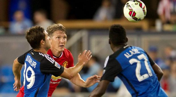 Manchester United's Bastian Schweinsteiger (2nd from L) in action last night
