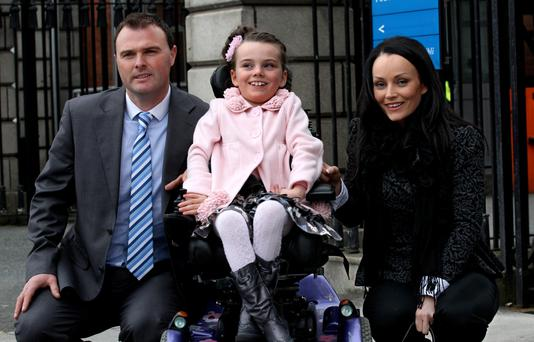 File photo: Alex Butler with parents John and Sonya. Photo: CourtPix