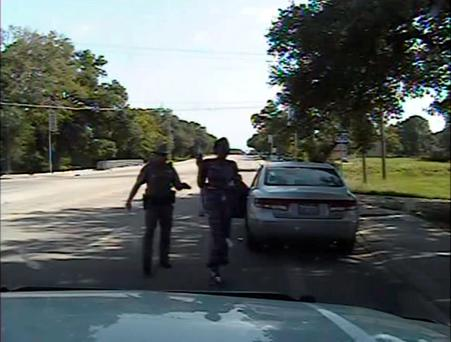 A Waller County Department of Public Safety officer points a Taser as he orders Sandra Bland out of her vehicle, in this still image captured from the police dash camera video from the traffic stop of Bland's vehicle in Prairie View, Texas, July 10, 2015. REUTERS/The Texas Department of Public Safety/Handout via Reuters