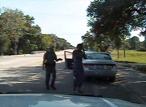 In this July 10, 2015, frame from dashcam video provided by the Texas Department of Public Safety, trooper Brian Encinia arrests Sandra Bland after she became combative during a routine traffic stop in Waller County, Texas. (Texas Department of Public Safety via AP)