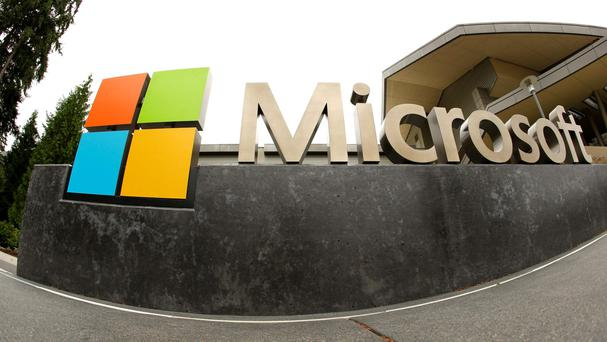 FILE - This July 3, 2014, file photo, shows the Microsoft Corp. logo outside the Microsoft Visitor Center in Redmond, Wash. (AP Photo Ted S. Warren, File)