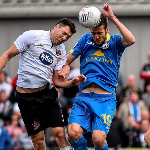 Dundalk's Brian Gartland (left) in action against Nemanja Milunovic of BATE Borisov during the UEFA Champions League Qualifier at Oriel Park.