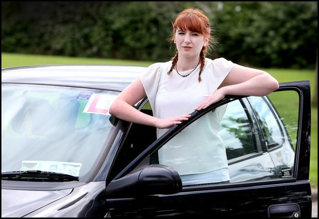 Katie Morris from Blanchardstown with her 98D Opel Corsa car. She pays more in Insurance than the car's worth. Pic Steve Humphreys 22nd July 2105.