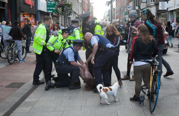 22/07/2015 Supporters & members of the Real-Productive Health and Workers Solidarity Movement being arrested by Gardai after trying to unfurl a banner on the roof of the GPO during a solidarity protest Photo: Gareth Chaney Collins