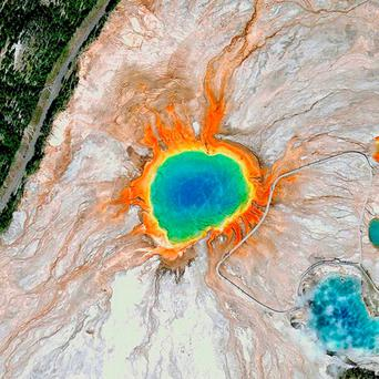 Grand Prismatic Spring: At the Grand Prismatic Spring in Yellowstone National Park, visitors can get a close-up view on a series of elevated boardwalks. The hot spring gets its vivid colour from pigmented bacteria that grow around the edge of the mineral-rich water. Picture: DigitalGlobe/REX Shutterstock
