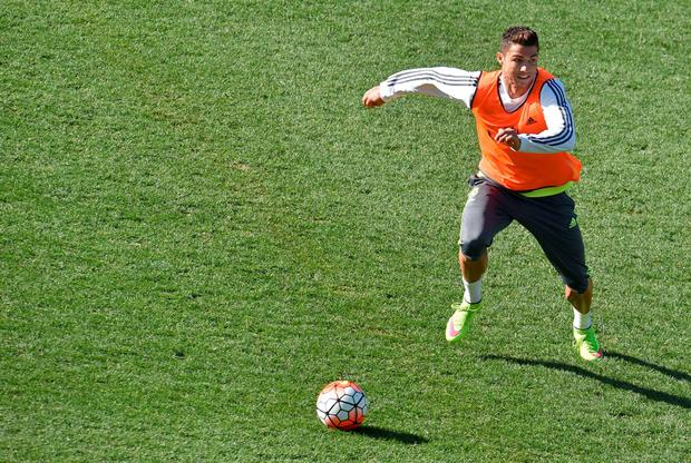 Real Madrid's Cristiano Ronaldo controls the ball during a team training session at the International Champions Cup football tournament in Melbourne on July 23, 2015. AFP PHOTO / Paul CROCK -- IMAGE RESTRICTED TO EDITORIAL USE - STRICTLY NO COMMERCIAL USEPAUL CROCK/AFP/Getty Images