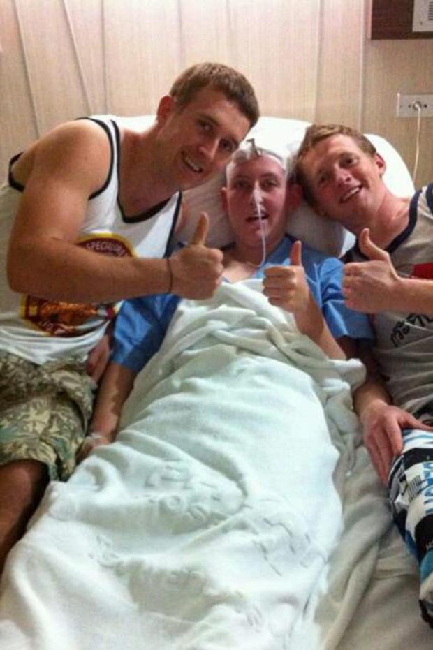 Lisa O'Donohue in hospital, with Martin O'Donoghue (brother) on the left and Neil Donohoe (cousin) on the rigHT