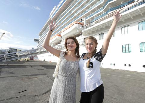 Ashley Bliss (22), left, and Alyssa Thomason (14), from California, after they disembarked from the Royal Princess cruise liner at Dublin Port yesterday