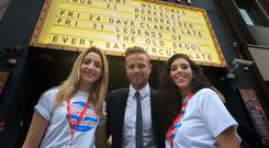 Nicky Byrne with (L to R) Kate Tunney & Chloe Smith (friends of students involved in the Berkeley collapse) during a fundraising concert for survivors of the Berkeley balcony collapse and their families at the Academy, Abbey Street, Dublin. Photo: Gareth Chaney Collins