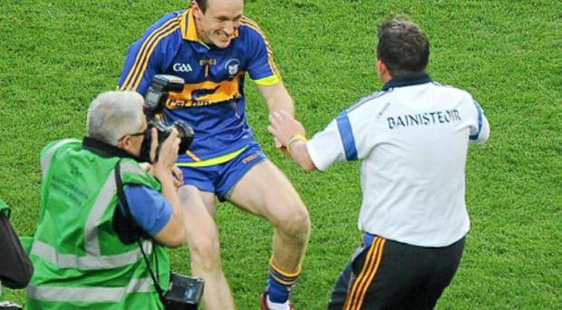 Patrick Kelly embracing Davy Fitzgerald after Clare's 2013 All-Ireland victory