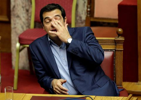 Greece's Prime Minister Alexis Tsipras reacts during an emergency parliament session in Athens. Photo: AP