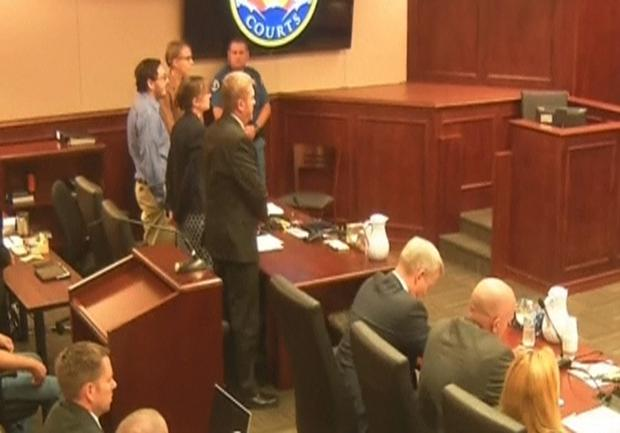 James Holmes (L) stands in court as the verdict is read in this still image taken from video in Denver, Colorado, July 16, 2015. REUTERS/Pool