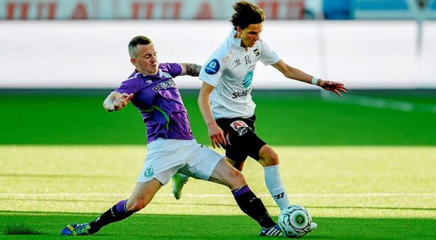 Rafik Zekhnini of Odds Ballklubb is tackled by Rovers' Gary McCabe