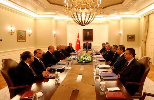 Turkey's Prime Minister Ahmet Davutoglu (C) chairs a security meeting in Ankara, Turkey